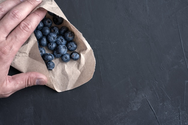 Raw blueberries in a paper bag