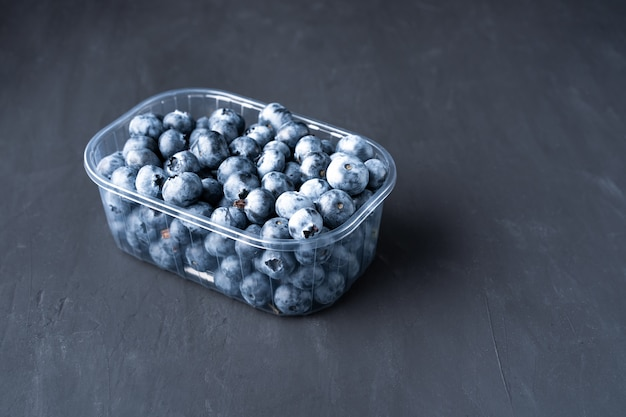 Raw blueberries in a plastic container