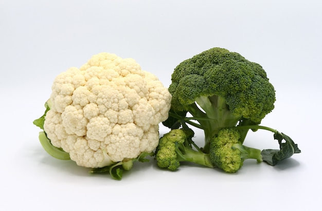 Raw broccoli and cauliflower on a light background. close-up.