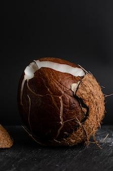 Raw broken coconut. tropical food concept.