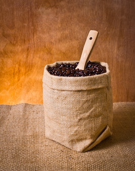Raw burlap sack black spoon