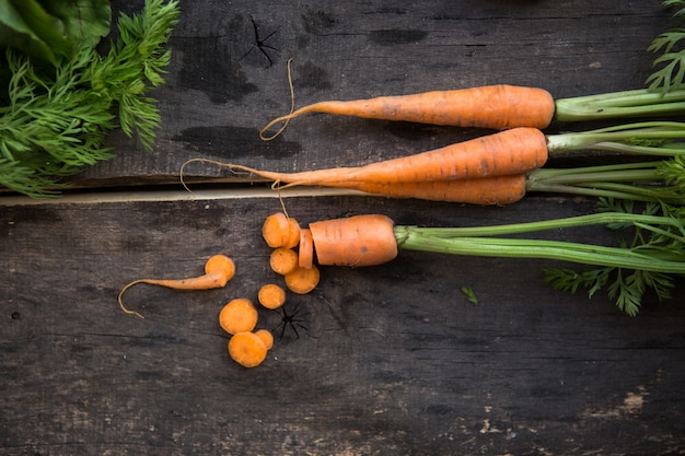 Raw carrots on rustic white wooden table