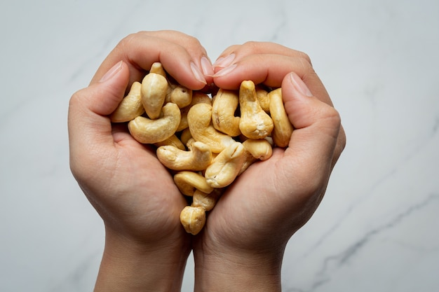 Raw cashews nuts on marble background