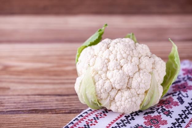 Raw cauliflower with patterned napkin
