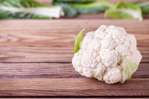 Raw cauliflower on wooden table