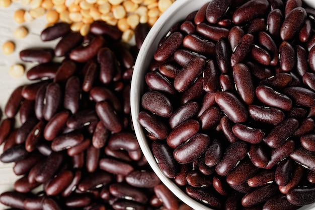 Raw cereals or beans in glass jars close up. vegan and vegetarian food.