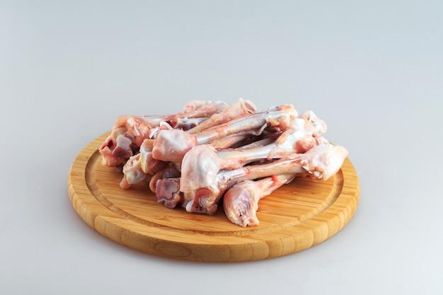 Raw chicken bones on white background