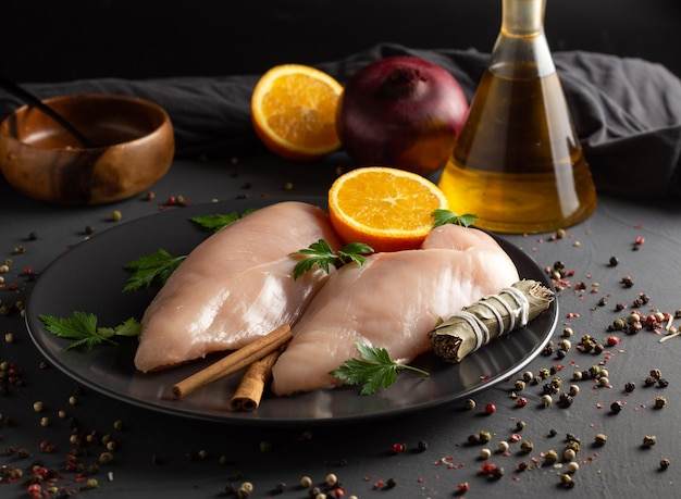 Raw chicken breasts prepared for cooking with ingredients