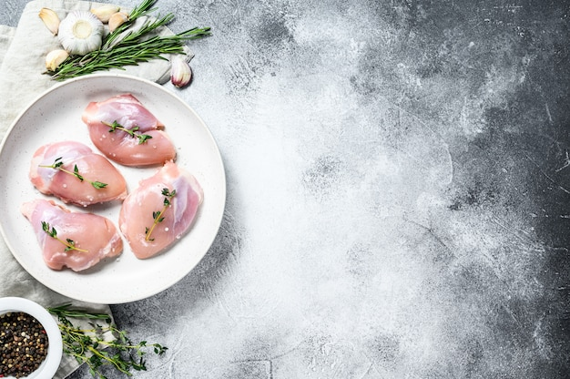 Raw chicken drumstick fillet. gray background. top view. space for text