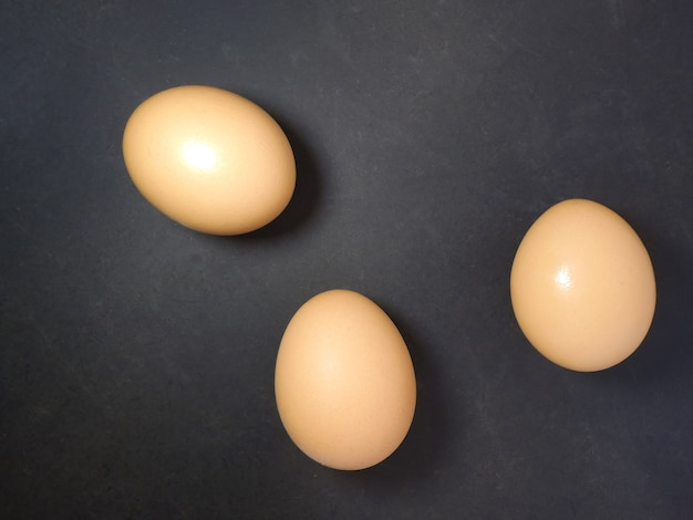 Raw chicken eggs. top view