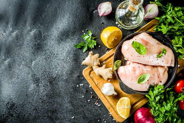 Raw chicken fillet with spices and herbs