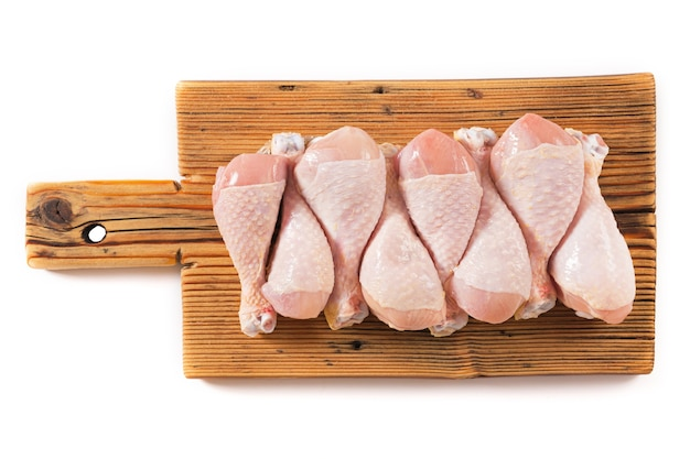 Raw chicken legs on the kitchen board isolated