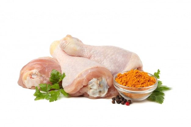 Raw chicken meat and spices isolated on white