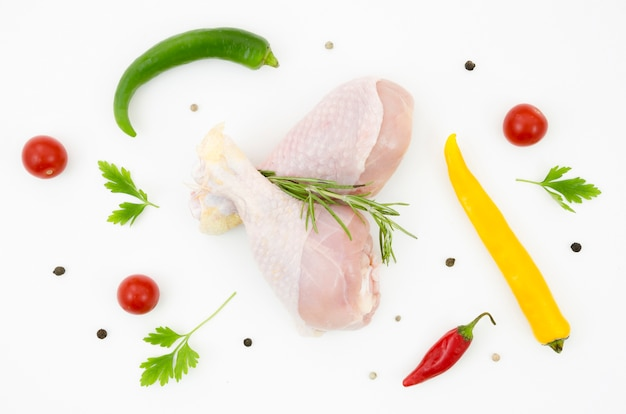 Raw chicken parts with different ingredients