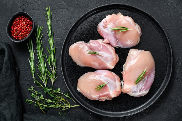 Raw chicken thigh fillet without skin. farm poultry meat. top view