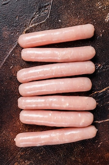 Raw chicken and turkey meat sausages on butcher table