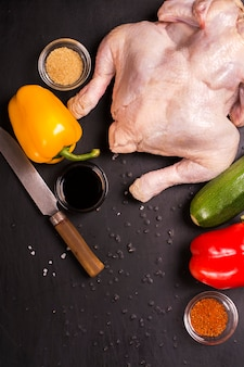 Raw chicken, vegetables and spices