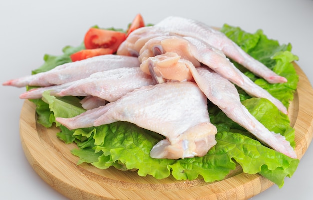 Raw chicken wings on white