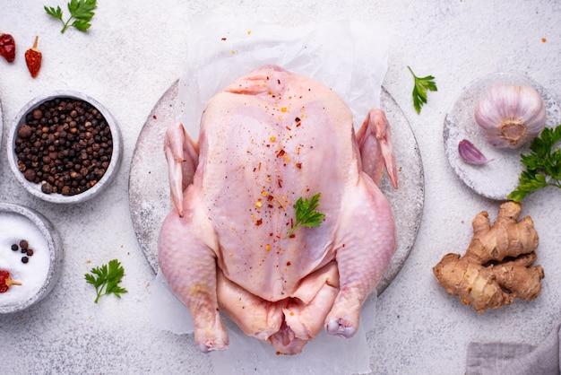 Сырая курица с зеленью и специями
