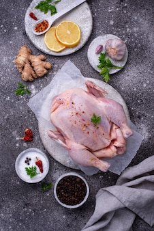 Raw chicken with herbs and spices