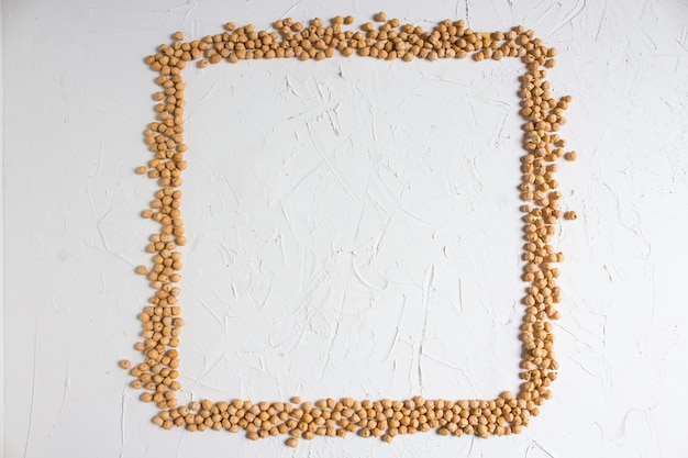 Raw chickpeas, frame of chickpeas on a light background