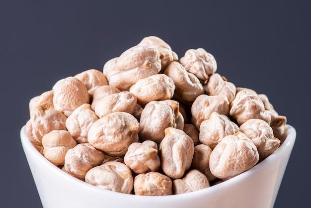 Raw chickpeas grains seen up close.