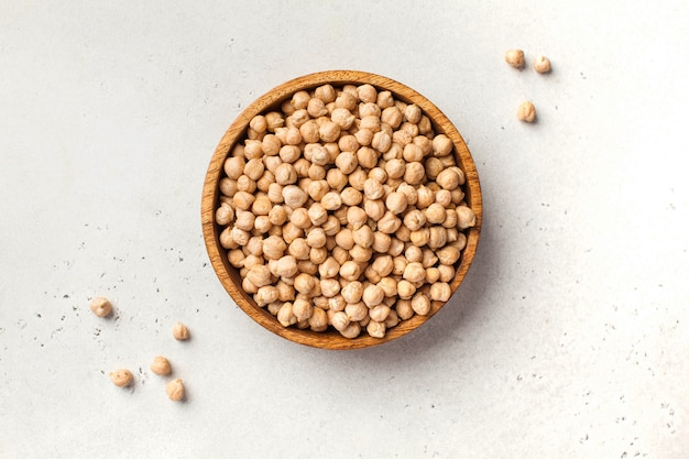 Raw chickpeas in a wooden bowl