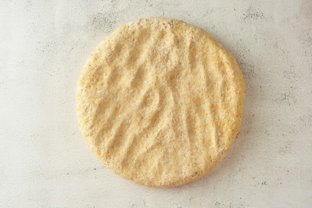 Raw circle dough. pastry or bread dough. bright background.