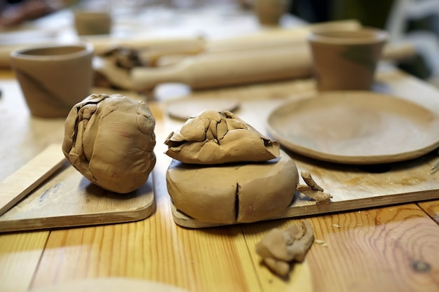 Raw clay on a wooden table, pottery