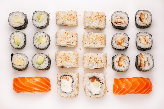 Raw colorful sushi set on a white background. top view. sushi pieces collection, isolated on white background