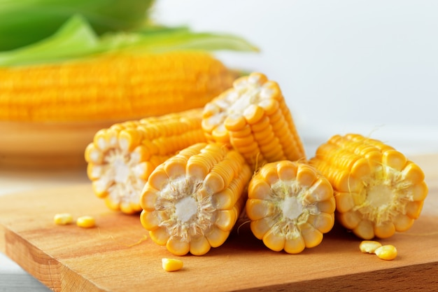 Raw corn on a wooden table