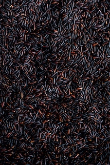 Raw dark red, balck purple rice, texture. riceberry pattern. food ingredient