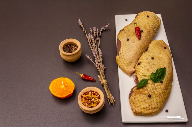 Raw duck breasts and spices. delicious ingredient for cooking healthy meal