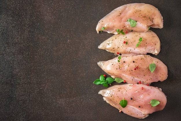 Raw fillet of chicken on rusty background. meat ingredients for cooking. top view.
