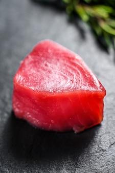 Raw fillet steak tuna. black wall. top view. close up