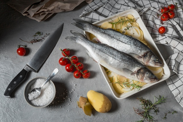 Raw fish arrangement for cooking