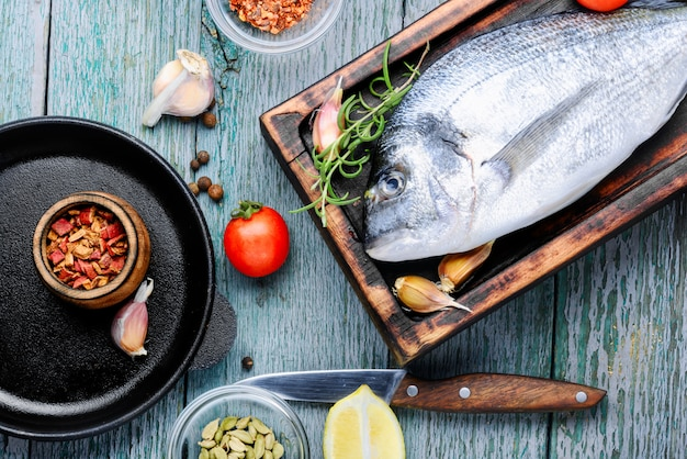 Raw fish and ingredients for cooking