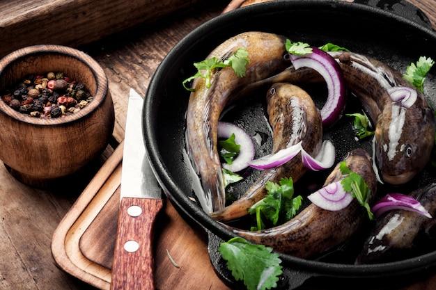 Raw fish in the pan