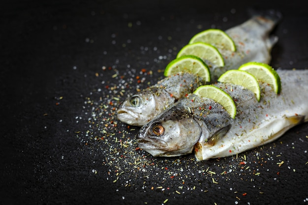 Raw fish with aromatic herbs, spices, salt and lime slices