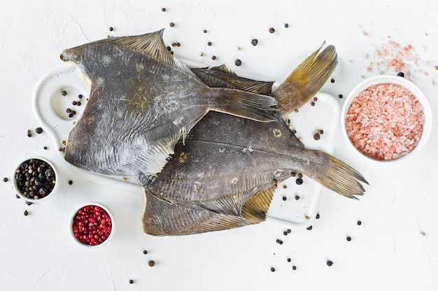 Raw flounder, ingredients for cooking.