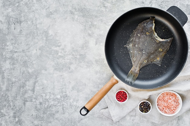 Raw flounder in the pan.