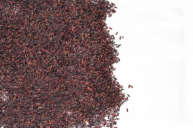 Raw food rice  with rows of black rice and white isolate background