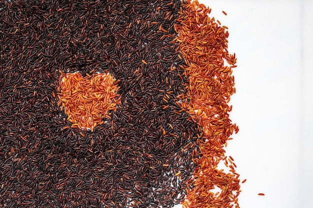 Raw food rice  with two rows of black and red rice for white isolate background