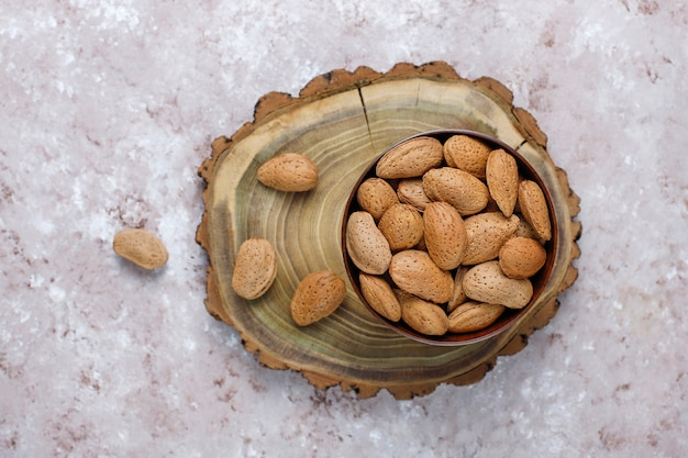 Raw fresh almonds with shell.