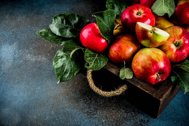 Raw fresh apples in wooden tray