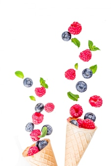 Raw fresh blueberry and raspberry isolated on white, simple pattern