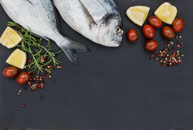 Raw fresh dorado fish on slate cutting board. top view, copy space.