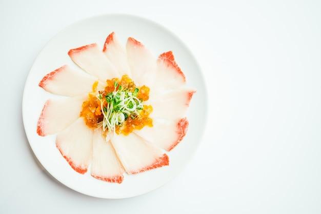 Raw fresh hamaji fish meat sashimi in white plate