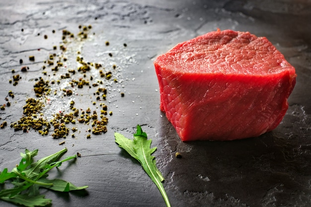 Raw fresh marbled filet mignon steaks on black stone background