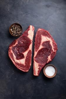 Raw fresh marbled meat steak ribeye.